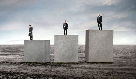 excel: Three business people standing on cubes at different levels