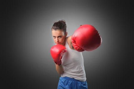 match box: Young woman playing boxe Stock Photo