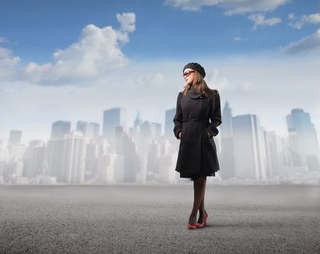 Elegant woman with cityscape on the background photo