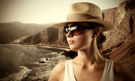 Beautiful woman witj seascape on the background photo