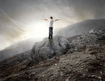 Child standing on a rock with open arms Stock Photo - 7875464