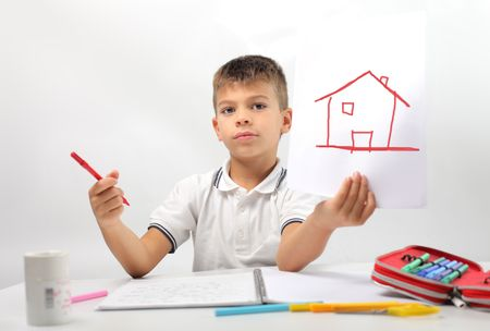 Child showing the drawing of a house photo