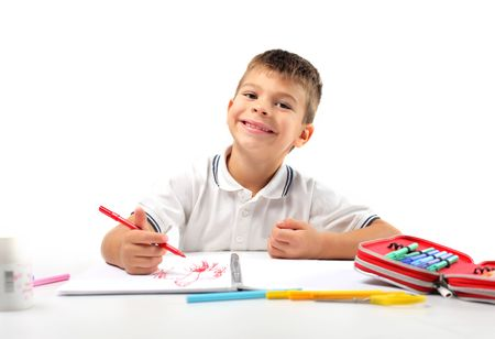 Smiling child drawing photo
