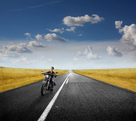 moto: Biker driving on a countryside road