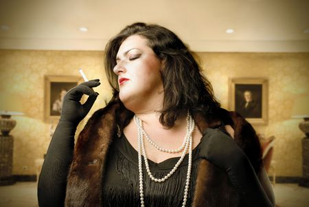 fat lady: Rich and fat woman smoking a cigarette in a luxury house Stock Photo