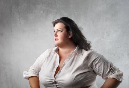 grasse: Femme en gras avec expression triste  Banque d'images