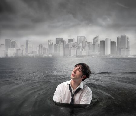 Wet businessman in the water with stormy sky above him Stock Photo - 7955581