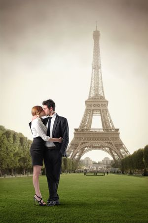 romantic kiss: Couple kissing with Eiffel Tower on the background
