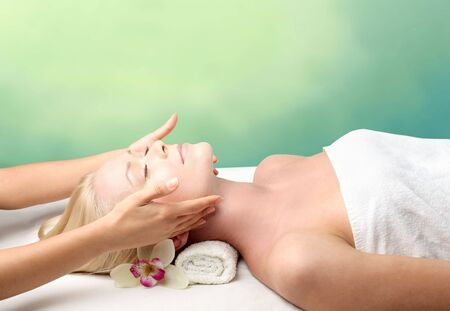 massage hands: Beautiful woman relaxing during a beauty treatment
