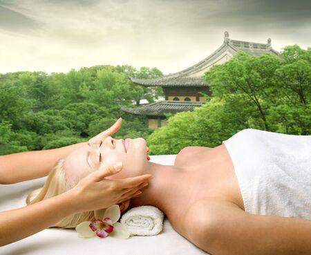 Beautiful woman relaxing during a beauty treatment photo