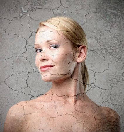 aging face: Smiling beautirul woman with cracked background