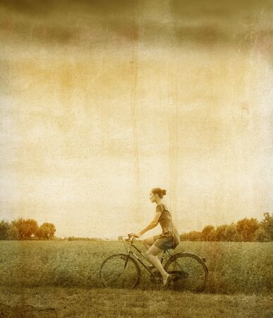 Vintage portrait of a woman riding a bike in the country Stock Photo - 8054415