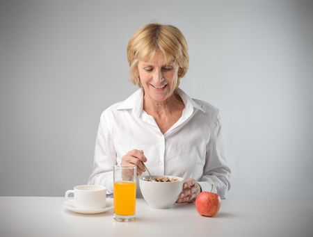 smiling woman having breakfast photo