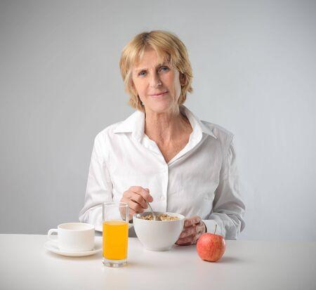 Woman having breakfast photo