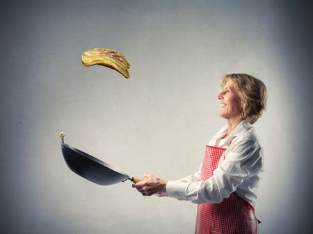 Woman cooking an omelet photo