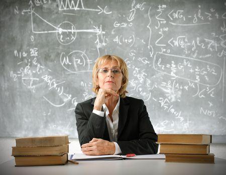 Teacher sitting in a classroom photo