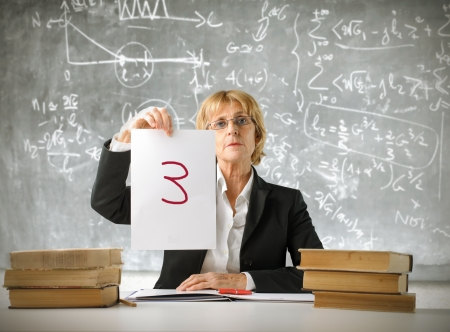 bad woman: Severe teacher showing a bad note Stock Photo