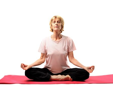Senior woman doing yoga exercise photo