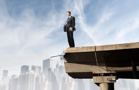 peril: Businessman standing on the edge of a bridge