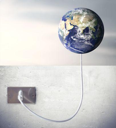 enchufe de luz: Tierra conectado a una toma de luz  Foto de archivo