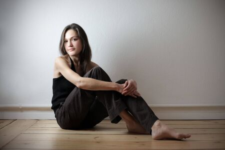 Beautiful woman sitting on the floor Stock Photo - 8193046