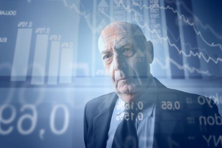 Senior businessman with stock exchange graphics on the background