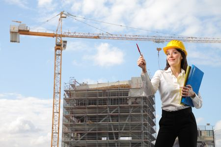 female architect: Female architect with construction site on the background
