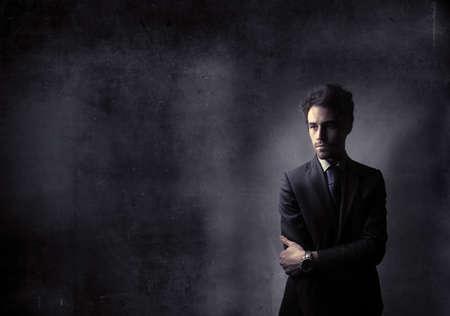 Dark businessman with dark background Stock Photo - 8312673