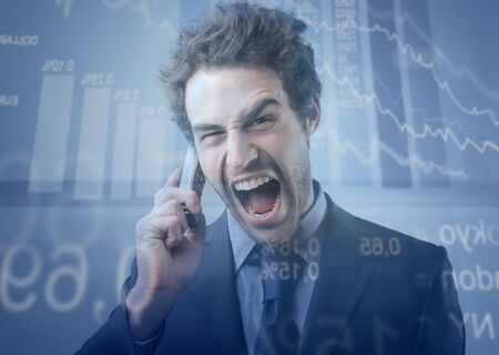 vend: Young stock exchange broker with aggressive expression screaming at telephone with stock exchange graphics on the background