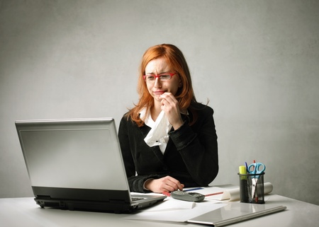 handkerchief: Young businesswoman crying in front of a laptop Stock Photo
