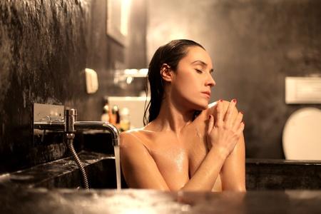 Beautiful woman enjoying a bath photo