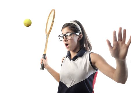 clumsy: Young girl playing tennis Stock Photo