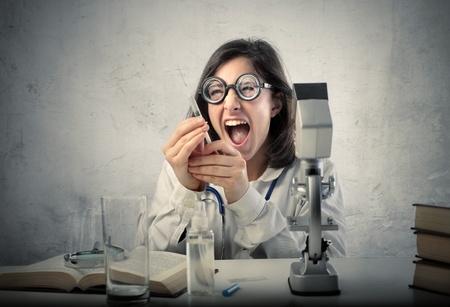 Crazy scientist holding a syringe