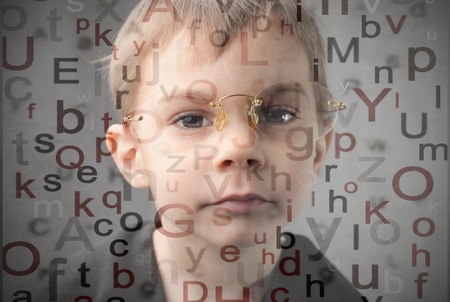 intellect: Child wearing glasses and alphabet letters on the background