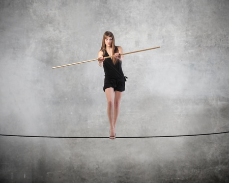 peril: Beautiful woman standing on a rope