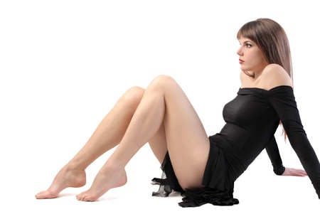 woman legs: Seated beautiful woman with long legs Stock Photo