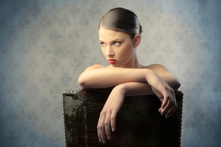 vintage portrait: Beautiful woman sitting on a chair Stock Photo