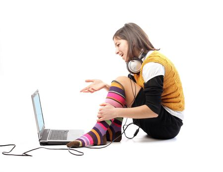 Smiling young woman sitting in front of a laptop Stock Photo - 8656289