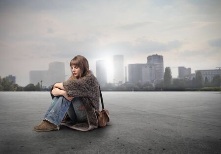 hippie woman: Seated young woman with cityscape on the background