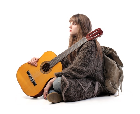 Young woman with backpack and guitar photo