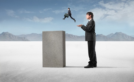 smaller: Businessman helping a smaller one to jump on a high cube