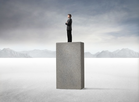 ascend: Businessman standing on a high cube Stock Photo