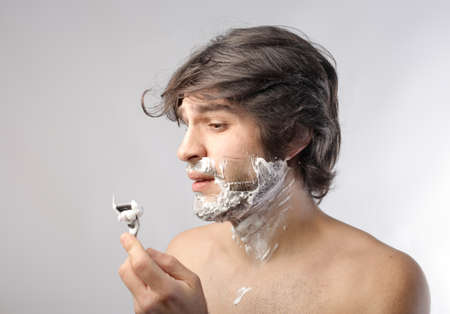 Young man wounded while shaving photo