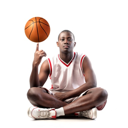 Young african basketball player holding a ball on his finger Stock Photo - 8736533