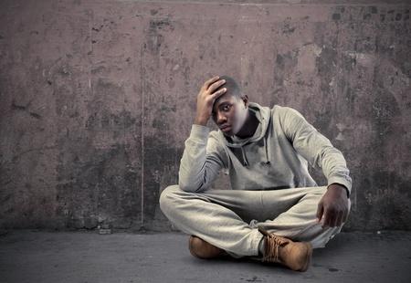 upset man: Sad young african man Stock Photo