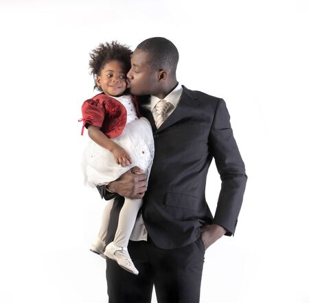 African businessman kissing his little daughter Stock Photo - 8852993