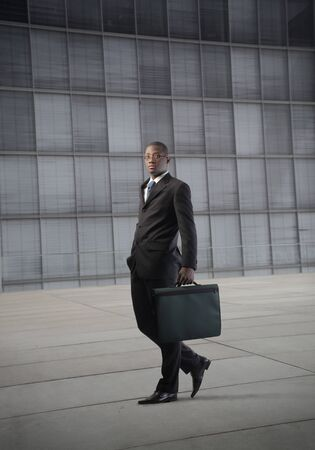 African businessman standing in front of an office building Stock Photo - 8853005