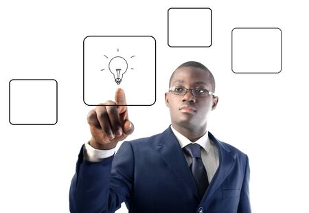 African man pressing a button with a light bulb on a touchscreen Stock Photo - 8852999