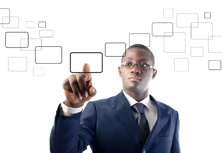 african business: African businessman pressing a button on a touchscreen