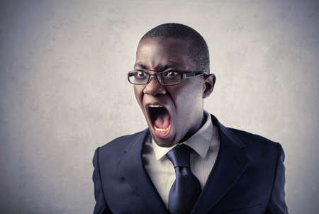 Angry african businessman screaming Stock Photo - 8853004